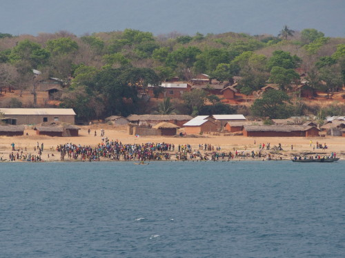 village, people gathering on the beach