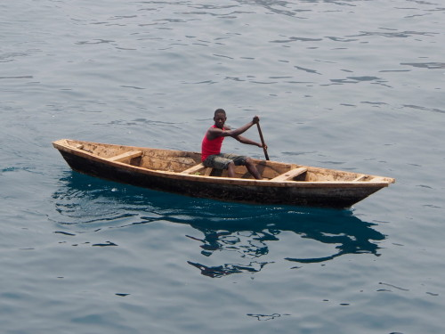 guy in small boat